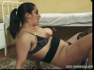 Hairy mature zoophilia at home with her dog