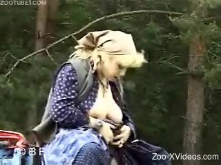 Busty MILF in blue dress gives her pony a blowjob