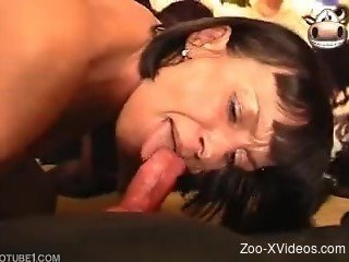 Filthy brunette MILF is sucking a doggy dick