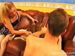 Skinny chick sucks a doggy in front her lovely hubby