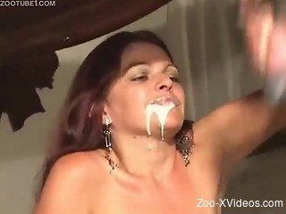 Redhead gets full mouth of horse's dense sperm
