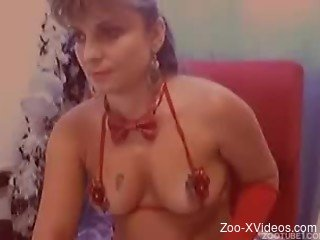 Big-boobed zoophilic whore and her cute white pet